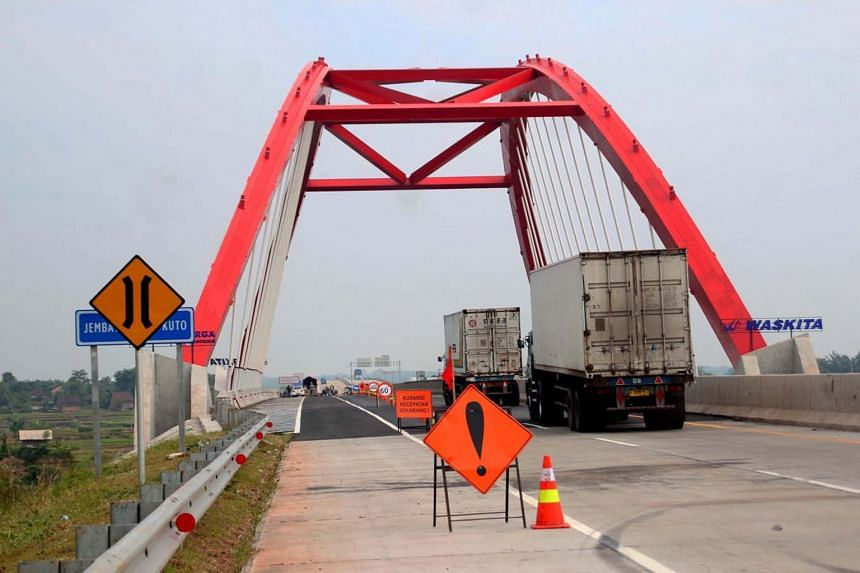Vehicles crossing a bridge on the toll road between Batang and Semarang in Indonesia's Central Java province. A 4,300ha industrial estate in Batang is slated to open for business in the near future, tapping into demand from manufacturers diversifying