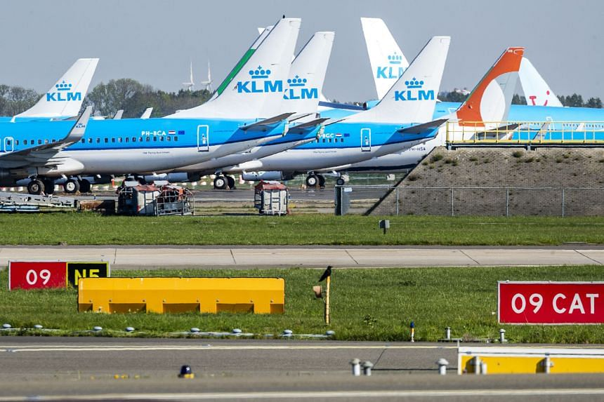 KLM planes parked on the tarmac of Schiphol airport in Amsterdam in April amid a lockdown in the Netherlands. The Dutch carrier said its planned job cuts were necessary as it had made huge losses despite a €3.4 billion (S$5.5 billion) government ba