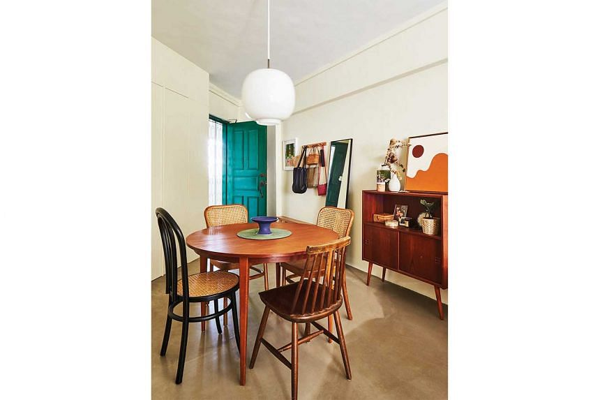 Not ones to shy away from the unconventional, the owners used different styles of dining chairs for an eclectic look.