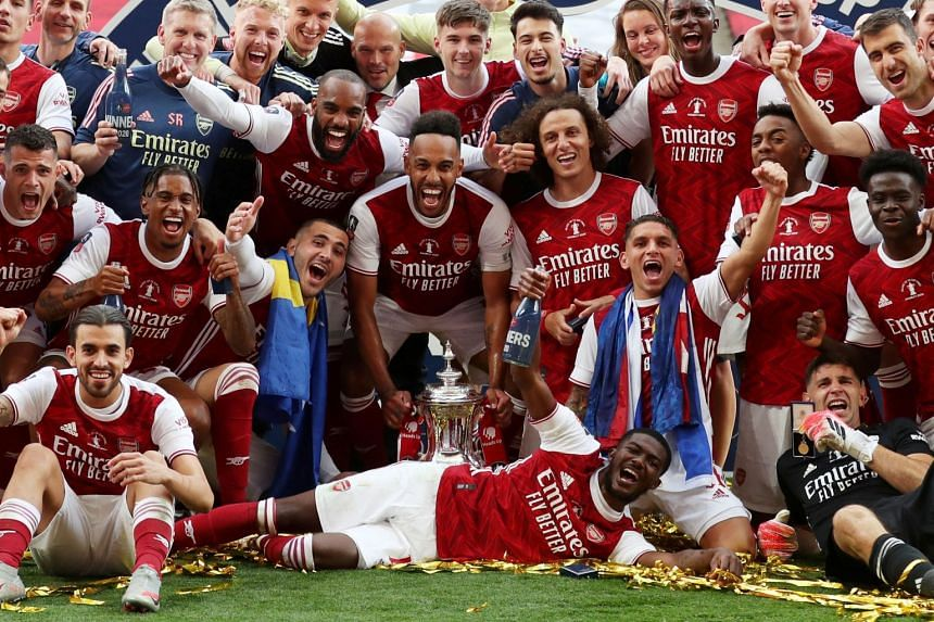 Arsenal's Pierre-Emerick Aubameyang celebrates with the trophy and teammates after Arsenal beat Chelsea to win the FA Cup.
