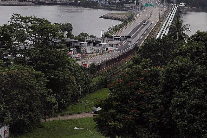The empty Causeway on July 26. Some Malaysian students studying at Singapore universities are willing to bear quarantine costs and the 1km walk across the Causeway to return to campus, while others will continue with online classes or defer their sem