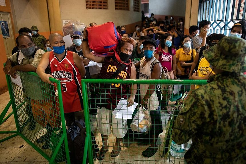 Filipinos stranded because of Covid-19 restrictions crammed inside Manila's Rizal Memorial Sports Complex, while waiting for transport back to their provinces on July 25. Philippine healthcare professionals insist current plans are not working, citin
