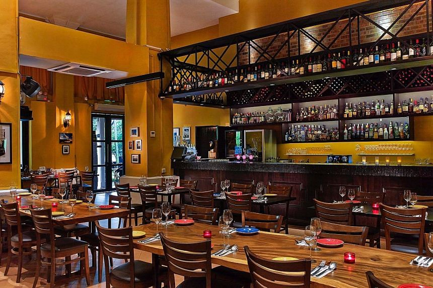 Spanish restaurant Don Quijote (left) is moving from Dempsey Hill to the 7th Mile Coffee Shop in Bukit Timah. Violet Oon Singapore at Bukit Timah (far left) has closed as the restaurant group has decided not to renew the lease for that outlet.
