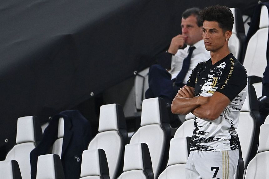Juventus' Cristiano Ronaldo watches from the sidelines.