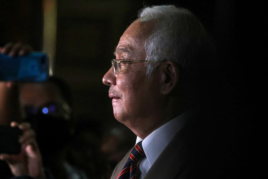 Former Malaysian Prime Minister Najib Razak speaks during a news conference outside Kuala Lumpur High Court on July 28, 2020.