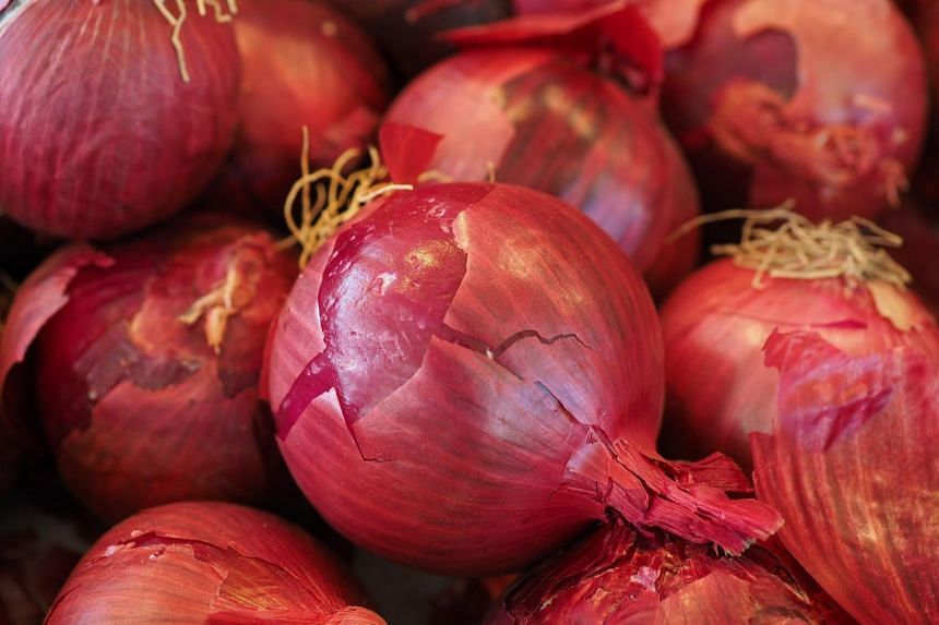 Health officials recommend that consumers throw away any onions or foods made with onions supplied by Thomson International.