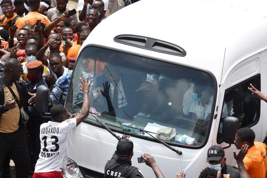 Supporters greet Didier Drogba (inside bus) after the submission of his candidacy for next month's Ivory Coast Football Federation elections.