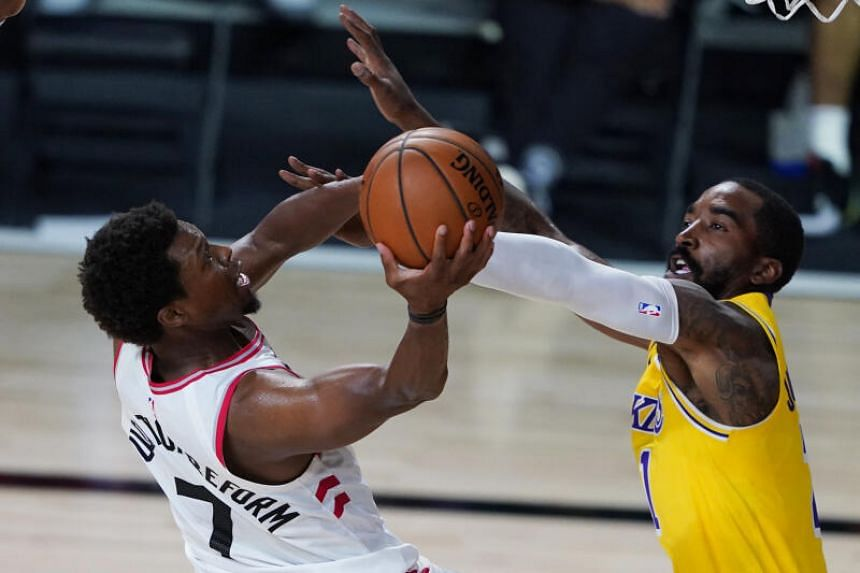 Kyle Lowry of the Toronto Raptors (left) is seen during a game against the Los Angeles Lakers in Florida on Aug 1, 2020.