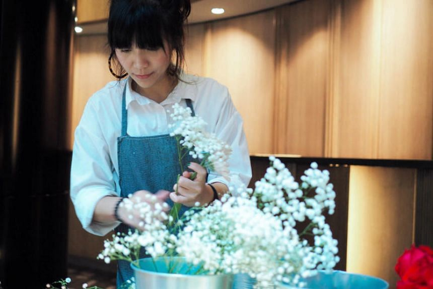 Florist Pang Hui Ya, who co-owns 7pm Bloom, says that turnover has fallen by around 80 per cent.
