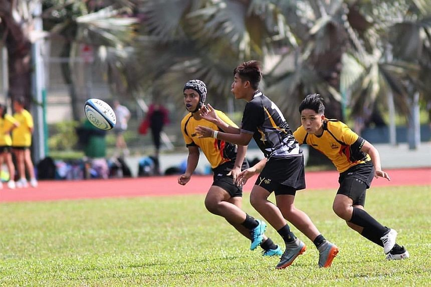 Jared Khuan (right) taking on Peirce Secondary School on Feb 3 in Bukit Batok Secondary's only B Division rugby game this year. The Sec 4 student was banking on good performances in the competition to secure a place at St Andrew's Junior College via