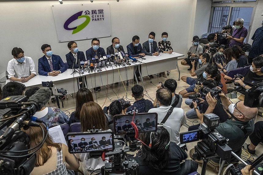 Some Civic Party members who were barred from the election in Hong Kong at a news conference last Thursday, after the city's government banned opposition candidates and arrested activists under a sweeping security law for comments made online.