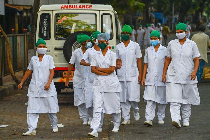 Nurses arrive at the King Edward Memorial hospital in Mumbai on May 12, 2020.