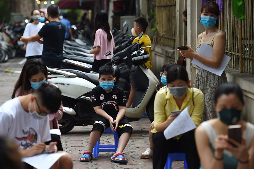 Residents waiting to be tested at a makeshift rapid testing centre as Vietnam records a rise in cases of the coronavirus, in Hanoi, on July 31, 2020.