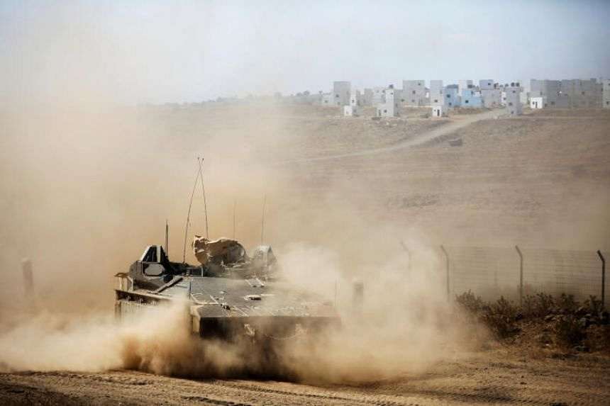 An Israeli military armoured vehicle manoeuvres in the Golan Heights near the Israel-Syria frontier on Aug 3, 2020.
