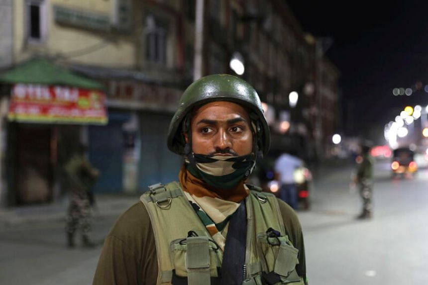 Indian paramilitary soldiers stand guard during lockdown in Srinagar, Kashmir, on Aug 3, 2020.
