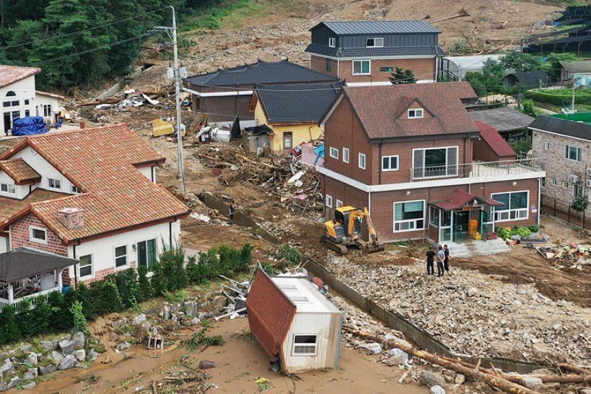 A photo taken on Aug 4 shows damage to a village near Anseong, South Korea, following a landslide amid heavy rain.