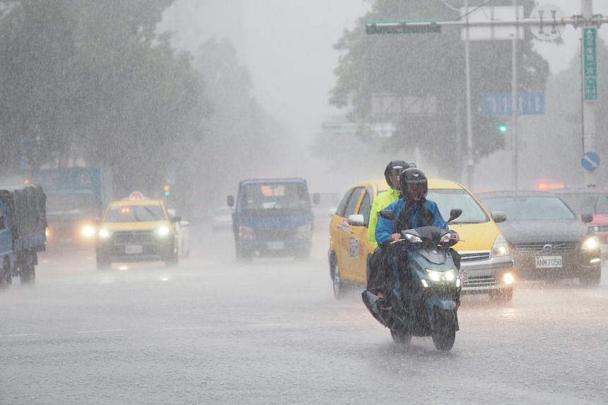 Motorists driving through the rain brought on by Typhoon Hagupit in Taipei, Taiwan, on Aug 3, 2020.