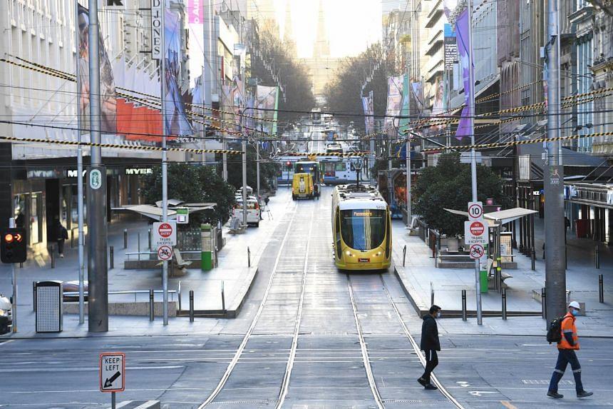 People walking along Bourke Street Mall in Melbourne, Australia, on Aug 4, 2020.