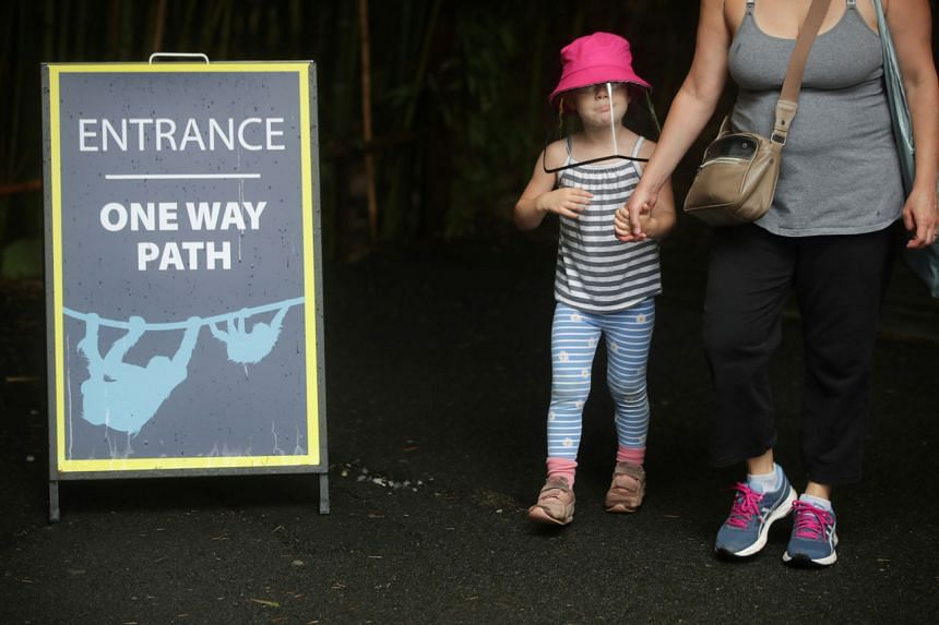 A child wears a protective face shield as the National Zoo in Washington, US, reopens for the first time since the start of the coronavirus outbreak, on July 24, 2020.