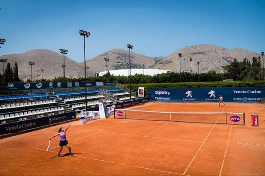 The WTA tournament in Italy started five months after the last one, with bottles of hand sanitiser attached to the nets