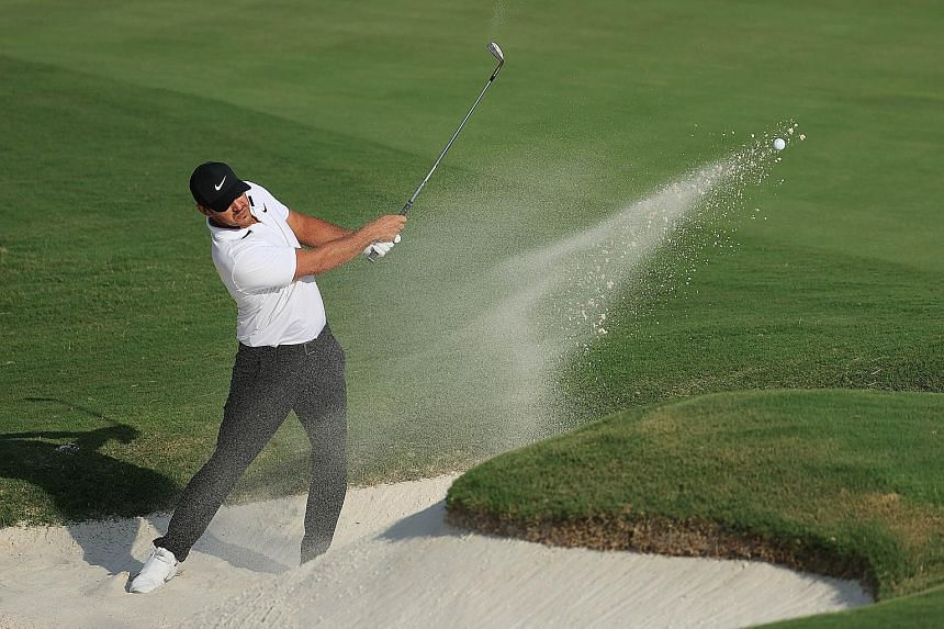 Brooks Koepka playing a shot from a bunker on the 18th hole during the final round of the WGC-FedEx St Jude Invitational on Sunday. He finished tied second and believes he is peaking just in time for his PGA Championship title defence.