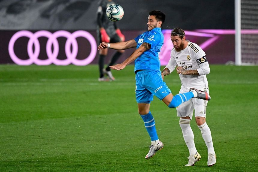 Torres (left) vies with Real Madrid's Spanish defender Sergio Ramos duringa match on June 18, 2020.