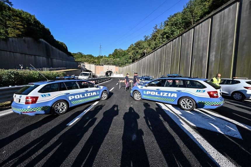 Highway Patrol police are seen before the opening of the new San Giorgio bridge for vehicles on Aug 4, 2020 in Genoa.