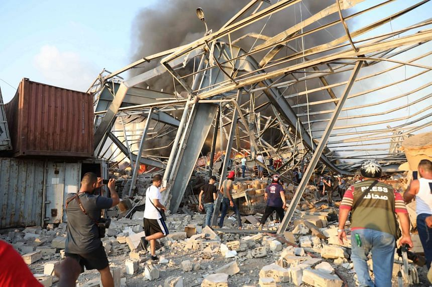People walk at scene of the explosion.