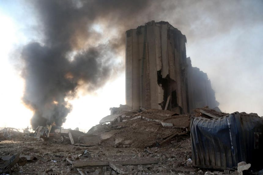 Smoke rises near a destroyed grain silo following the explosion at Beirut, Lebanon, on Aug 4, 2020.