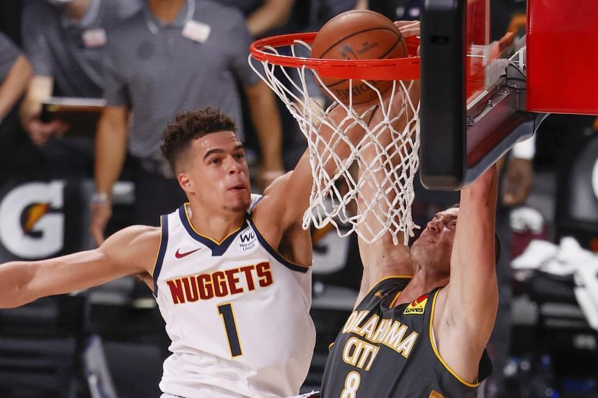 Denver Nuggets forward Michael Porter Jr. (left) fails to block the shot of Oklahoma City Thunder forward Danilo Gallinari in a game at the ESPN Wide World of Sports Complex in Florida on Aug 3, 2020.
