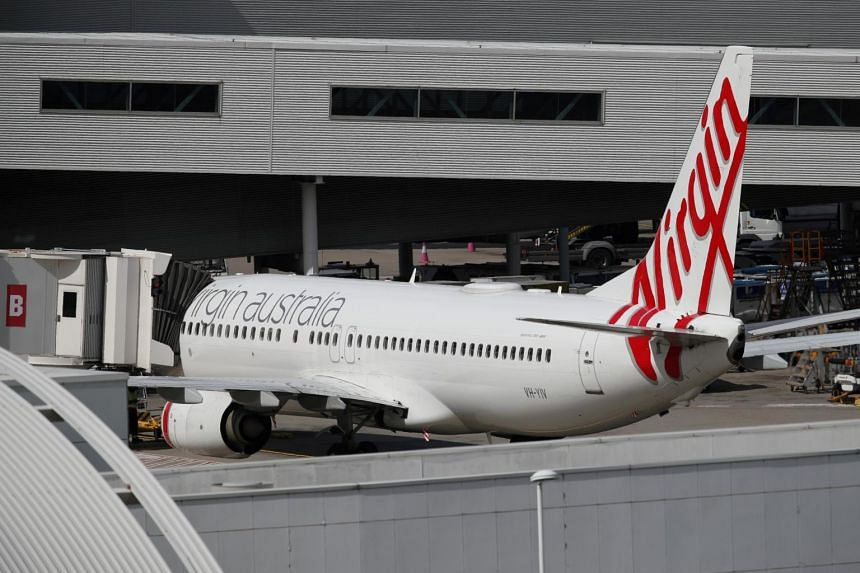 Virgin Australia cuts 3,000 jobs and plans to focus on shorter flights