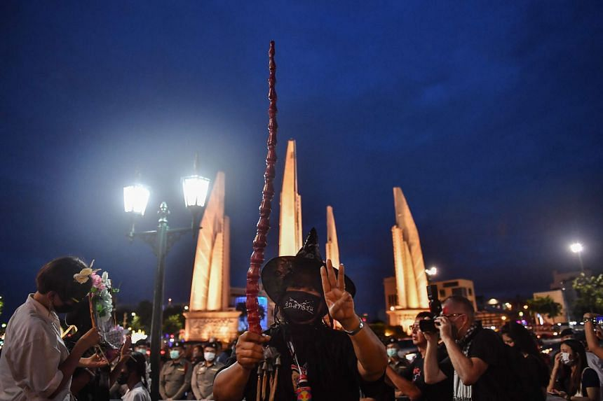 A protester flashing a three-fingered salute, portrayed in the Hunger Games books and films as a symbol of resistance, at a Harry Potter-themed rally in Bangkok on Monday. PHOTO: AGENCE FRANCE-PRESSE