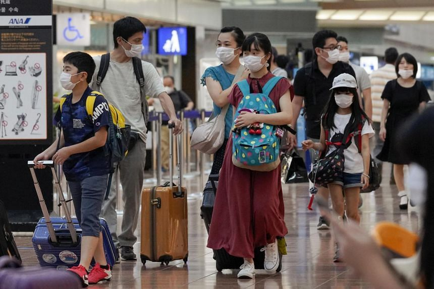 Cases have surged in recent weeks, hitting daily records in several cities in Japan.