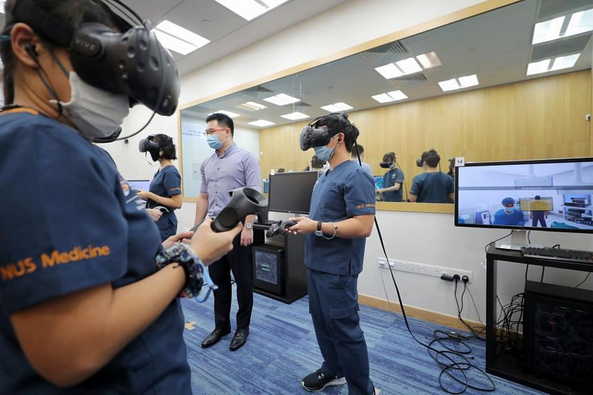 Students using the PASS-IT VR gaming tool at the NUS Yong Loo Lin School of Medicine on Aug 4, 2020.