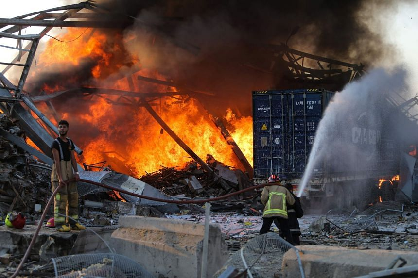 Firefighters douse a blaze at the scene of the explosion in Beirut on Aug 4, 2020.