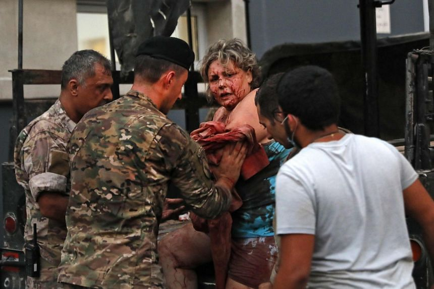 Wounded people receive help outside a hospital following the explosion.