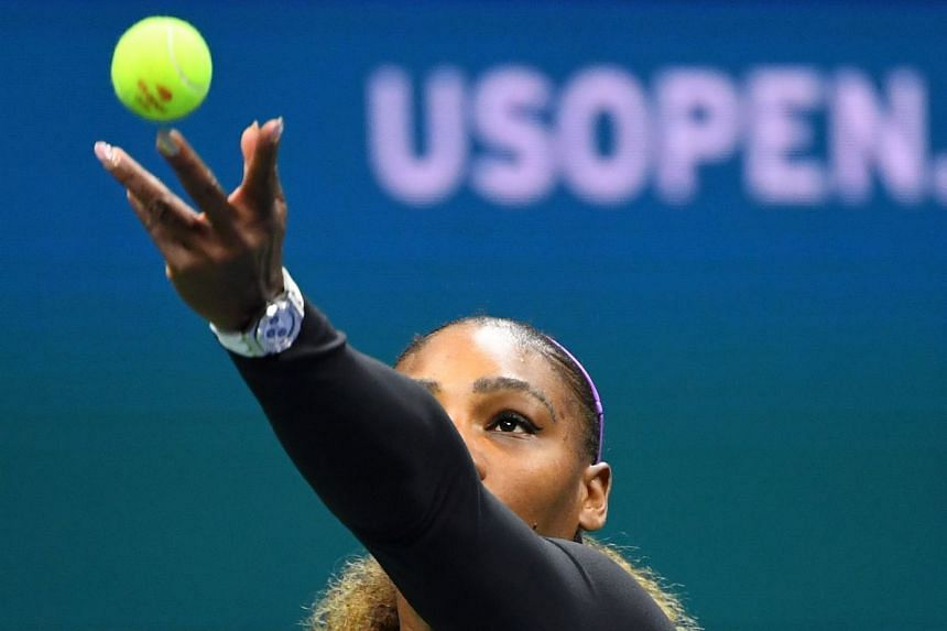 A 2019 photo shows Serena Williams of the US serving to Russia's Maria Sharapova on day one of the US Open.