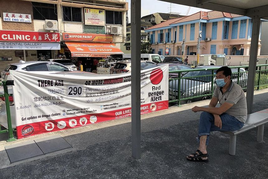 A red alert dengue banner at a bus stop in Geylang Road. The National Environment Agency has warned that even though dengue cases fell by more than 20 per cent last week, weekly numbers remain high. Singapore is in the midst of the traditional dengue