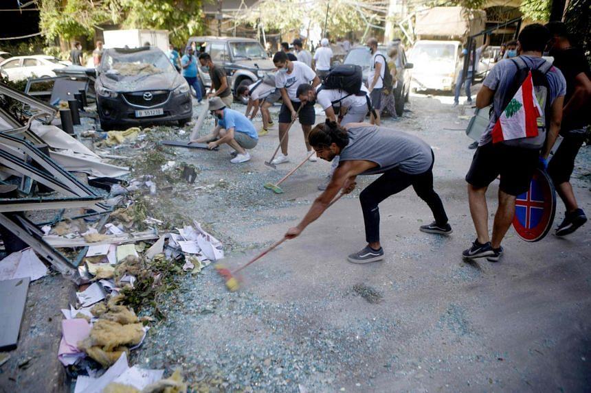 Lebanese activists cleaning the damaged neighbourhood of Mar Mikhail, on Aug 5, 2020.