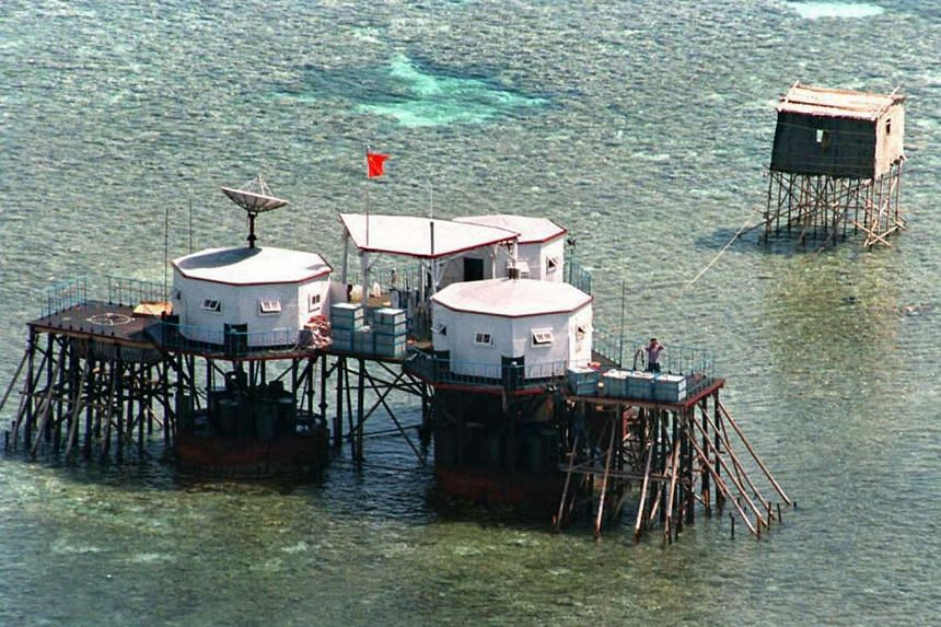 In a photo taken on April 1, 1995, China's flag is seen over octagonal structures built on stilts at the Manila-claimed Mischief Reef in the disputed Spratly Islands, known as Nansha islands by China, located in the South China Sea.