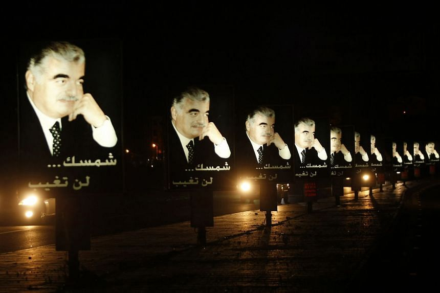 A 2012 photo shows billboards in Lebanon bearing portrait of Rafiq Hariri on the eve of the anniversary of his assassination.