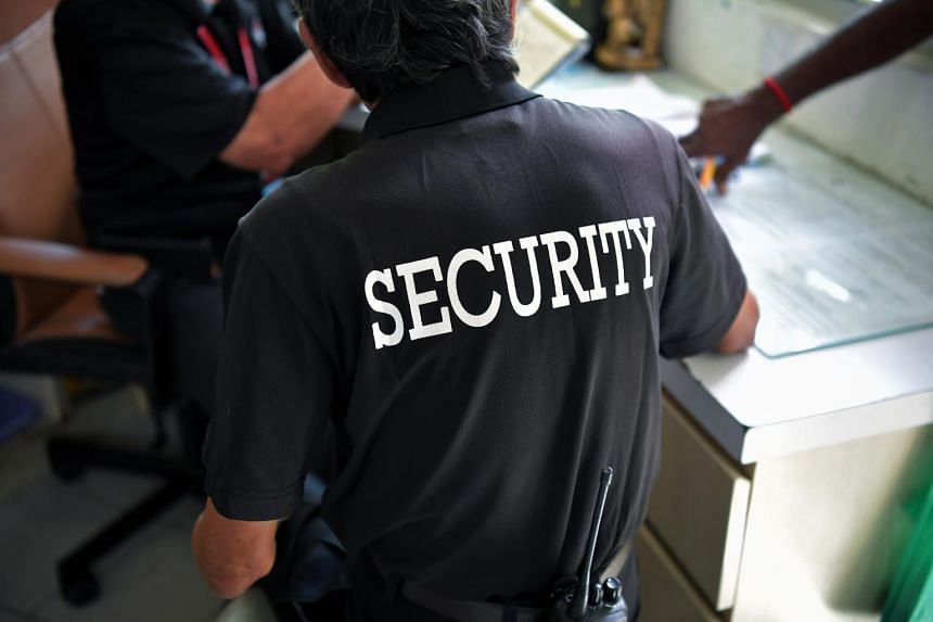 A photo from Feb 14, 2019, shows a security guard at a condominium in Upper Bukit Timah.