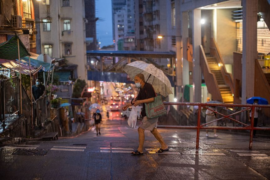 A man wears a face mask as he walks out of a market in Hong Kong, China, on Aug 5, 2020.