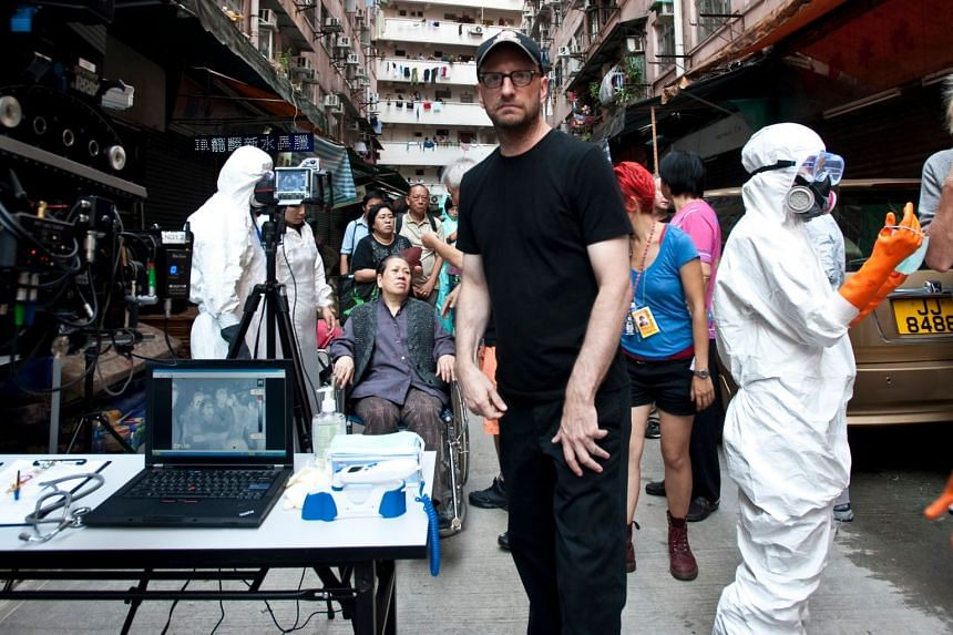 Film director Steven Soderbergh (centre) during the filming of Contagion. The 2011 pandemic thriller has found renewed interest from viewers in the uncertain days of Covid-19.