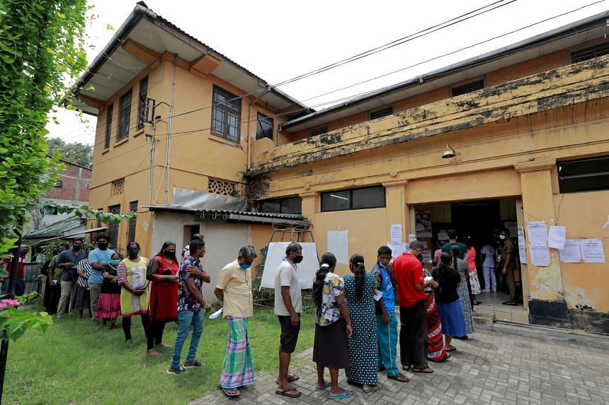 People waiting to cast their vote at a polling station during Sri Lanka's parliamentary election in Colombo yesterday. President Gotabaya Rajapaksa is seeking a two-thirds majority for his party in Parliament to enable constitutional reforms, so he c