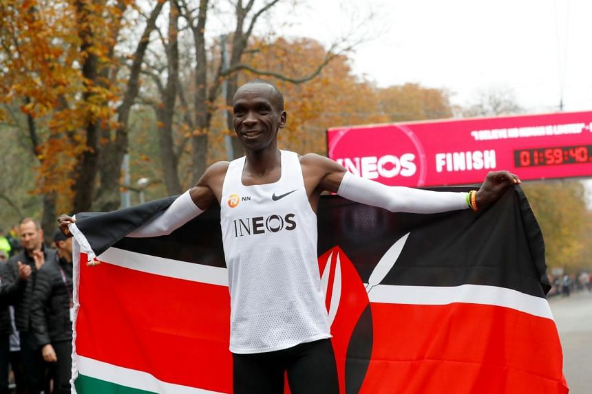 Kenya's Eliud Kipchoge celebrates after a successful marathon in under two hours in Vienna, on Oct 12, 2019.