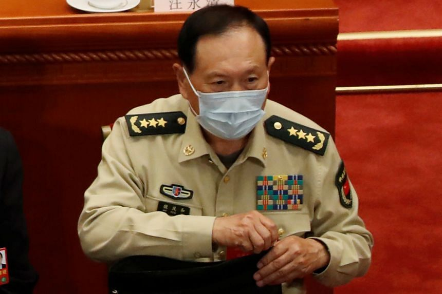 """China's Defence Minister Wei Fenghe (above, in May 2020) told his US counterpart in a 90-minute phone call to """"stop erroneous words and deeds"""""""
