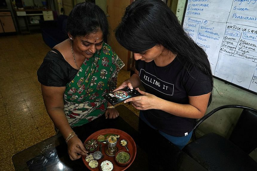 Mrs Geetha Sridha, who used to post clips on video-sharing app TikTok, making a video about her miniature food dishes with her daughter Sarada's help. Mrs Sridha said she will upload the video on an Indian app, following the Indian government's initi