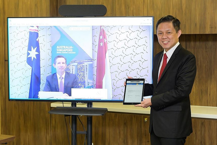Trade and Industry Minister Chan Chun Sing with his Australian counterpart Simon Birmingham at the virtual event. PHOTO: MINISTRY OF TRADE AND INDUSTRY