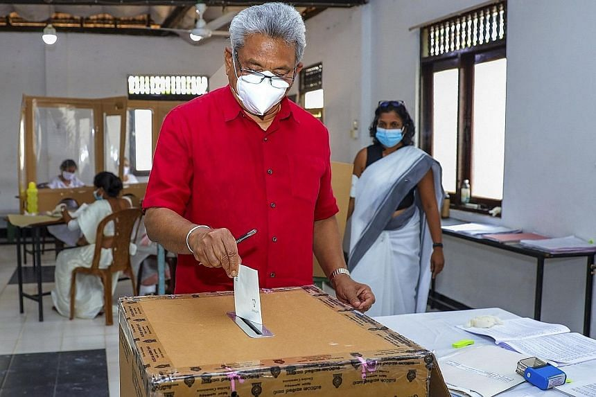Above: Sri Lankan President Gotabaya Rajapaksa casting his ballot at a polling station in Colombo. Right: A polling official carrying ballots to a counting centre. PHOTOS: AGENCE FRANCE-PRESSE, EPA-EFE